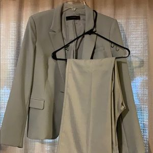 The limited brand new two piece suit large/14
